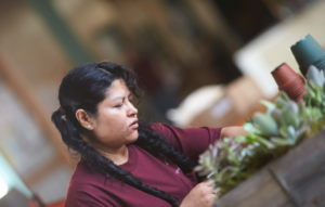 Alpha Fern Employee Arranging and Packaging Greenery