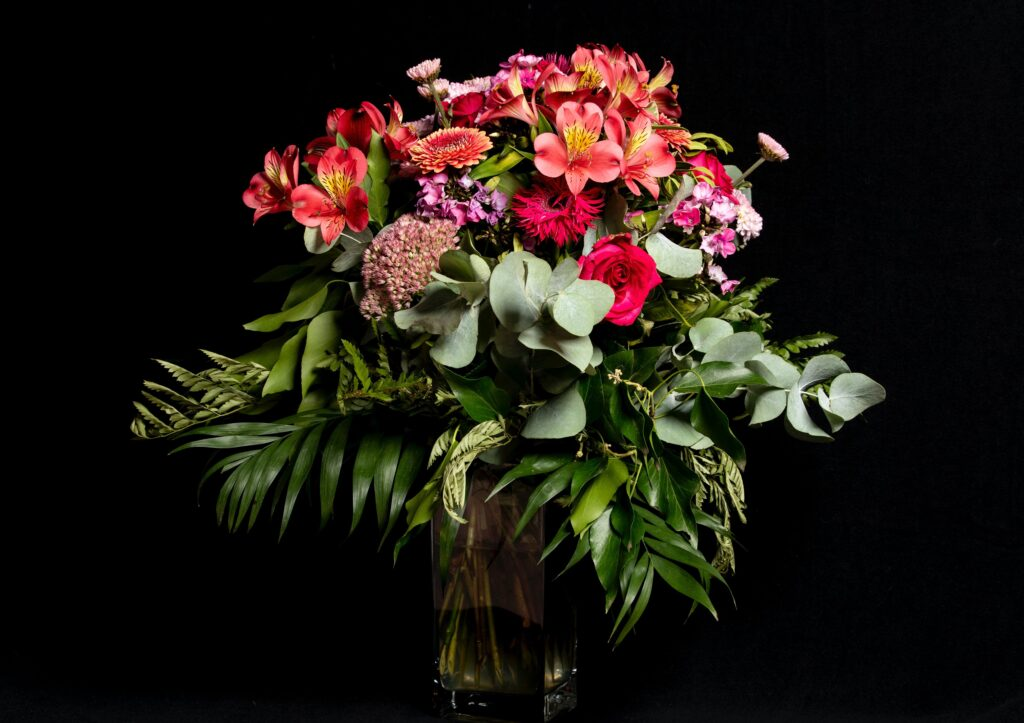 Floral arrangement with eucalyptus and other greenery